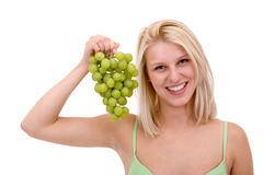 Women in bikini and grapes Royalty Free Stock Image