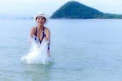Women with bikini play water Royalty Free Stock Photo
