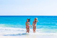 Women in bikni run to beach Royalty Free Stock Images