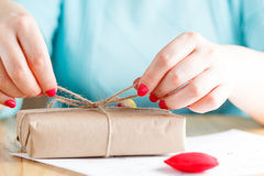 Women binds classic bow for gift Stock Images