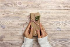Women binds classic bow for gift. Hands of woman decorating Christmas gift box Stock Photos