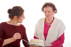 Women with birthday cake Stock Images