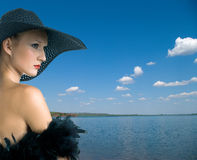 Women in black against summer landscape Royalty Free Stock Photo