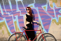 Women in black dress and bike Royalty Free Stock Photography