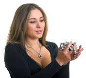 Women in a black dress holds in hands a bead Stock Photos