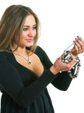 Women in a black dress holds in hands a bead Stock Photography