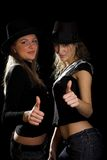 Women in black hats Stock Image