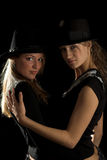 Women in black hats Royalty Free Stock Photography