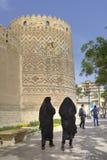 Women in black Islamic dress walk near Karim Khan citadel. Fars Province, Shiraz, Iran - 19 april, 2017: Two Iranian women in black Muslim clothes are walking Stock Photos