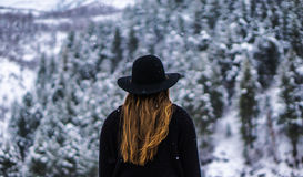 Women in Black Jacket Standing Infront of Snow Tree Stock Photography