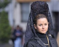 Women with black lace mantilla. Royalty Free Stock Image