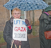 Women in black protesters. One of a group of 'Women in black' protesters with a banner saying ' Lift the blockade on Gaza ' in Inverness High Street on 29th Stock Photography