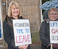 Women in black protesting. One of a group of 'Women in black' protesters with a banner saying 'Afghanistan time to leave ' in Inverness High Street on 29th Stock Photo