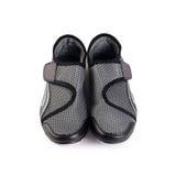 Women black stylish sport shoes isolated. Women stylish sport shoes isolated on white Stock Image