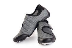 Women black stylish sport shoes isolated. Women stylish sport shoes isolated on white Royalty Free Stock Images