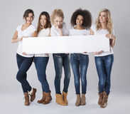 Women with blank board stock images