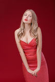 Women blonde  on red background Stock Photography