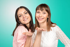 Women blowing a kiss at you Stock Photo