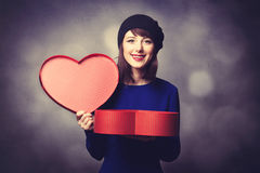 Women in blue dress with heart shape gift Stock Photo