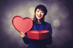 Women in blue dress with heart shape gift Stock Images
