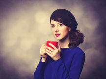 Women in blue dress with red cup Stock Photo