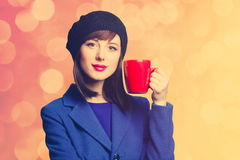 Women in blue dress with red cup Royalty Free Stock Image