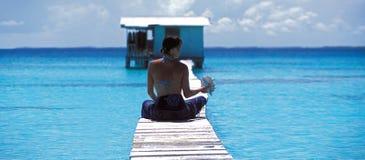 Women, blue lagoon , Polynesia Stock Image