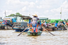 Women boating on the river agricultural trade Royalty Free Stock Image