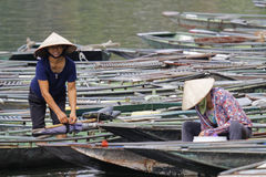 Women and boats on Hong Long river Royalty Free Stock Image