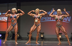Women Bodybuilding Winners Display Medals and Biceps Royalty Free Stock Photos