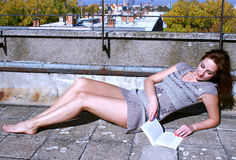 Women and Books. Beautiful woman lying on the terrace and read a book,photography Royalty Free Stock Photo