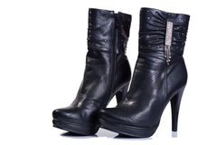 Women boots Black. Isolated on white Royalty Free Stock Images