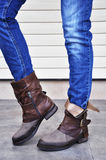 Women boots and jeans royalty free stock photos