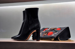 Women  boots and leather bag. Women elegant high-heeled boots and leather bag in store window Stock Photos