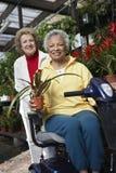 Women At Botanical Garden Royalty Free Stock Photos