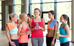 Women with bottles of water in gym Stock Image