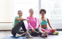 Women with bottles of water in gym Royalty Free Stock Image