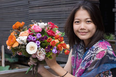 Women and bouquet flowers in hand vintage color st Royalty Free Stock Photography
