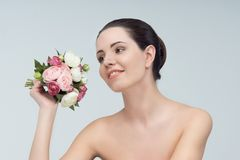 Women with bouquet Stock Photos