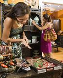Women in boutique. African American and Indian women shopping  in boutique Royalty Free Stock Photos