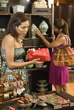Women in boutique. African American and Indian women shopping in boutique Stock Photography