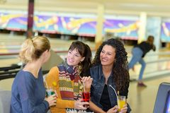 Women at bowling alley stock photos