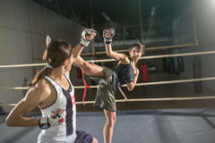 Women boxer practicing body combat attack Royalty Free Stock Photos
