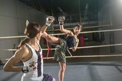 Women boxer practicing body combat attack Royalty Free Stock Photos