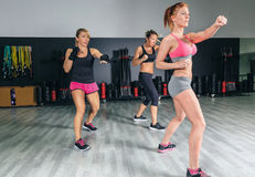 Women in a boxing class training punch Royalty Free Stock Photos