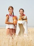 Women  with bread at field Stock Photos