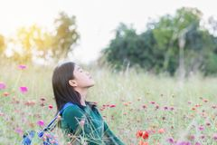 Women breathe oxygen in pure nature. Portrait woman in flower ga. Rden Royalty Free Stock Photography