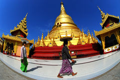 Women bring fruits Shwemawdaw Paya Pagoda. Stock Photography