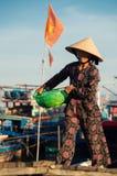 Women bringing in the fishing catch near Hoi An, Vietnam Stock Image