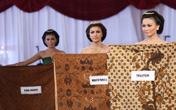 Women brought batik. Fabrics have different motives when the inaugural masters solo batik in Indonesia Central Java. batik motif has a wealth of diversity and Royalty Free Stock Photo